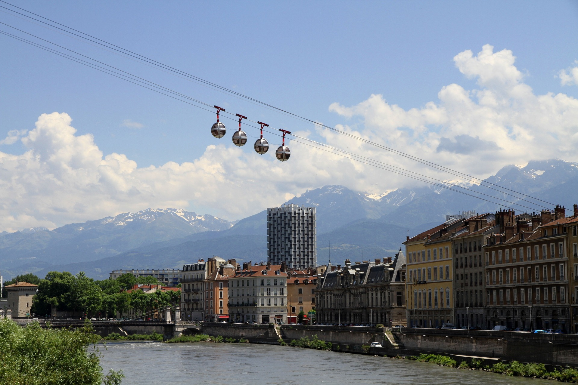The city of Grenoble, the Alps in the distance